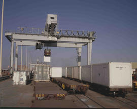 Johannesburg, 1983. Container being loaded onto train at City Deep container depot.
