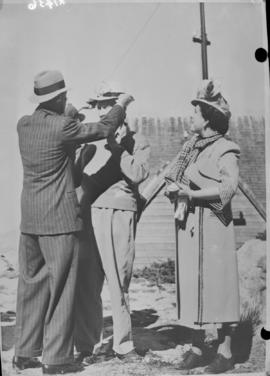 Cape Town, 21 April 1947. King George VI and Queen Elizabeth on Table Mountain adjusting the hat ...