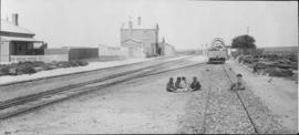 Swartkops, 1895. Goods wagon in station with small boys playing on railway line, viewed towards t...