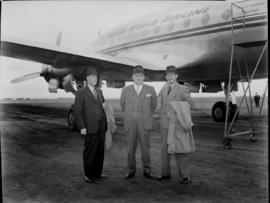 Three men outside TWA Lockheed Constellation 'Star of Madrid'.