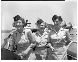 Vaal Dam, November 1949. BOAC Solent G-AHIX 'City of Edinburgh'. Three hostesses on passenger boat.