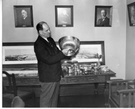 2 October 1942. Mr J Bennett at a Railway Museum display cabinet.