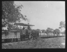 Roadrail tractor with goods wagons.