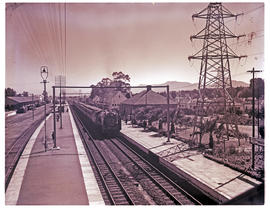 Paarl, 1952. SAR Class 15F with main line passenger trains at Huguenot railway station.