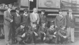 Worcester. Royal Train staff standing next to SAR Class GEA No 4018.