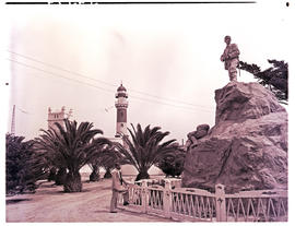Swakopmund, South-West Africa, 1952. Herero war memorial with lighthouse in the distance.