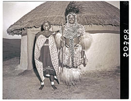 Natal, 1946. Zulu chief with first wife in front of hut.