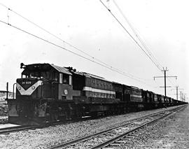 Vryheid district, 1978. SAR Class 34-600 No 34-629 heading five other locomotives and goods train.