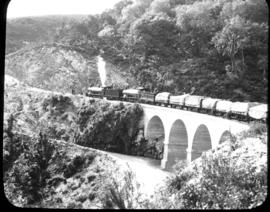 George district. A pair of SAR Class 7's on Montagu Pass viaduct in the Outeniqua mountains.