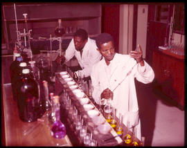 Chemists at work in analytical laboratory.