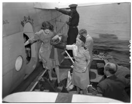 Vaal Dam, November 1949. BOAC Solent G-AHIX 'City of Edinburgh'. Hostess assisting passenger onto...