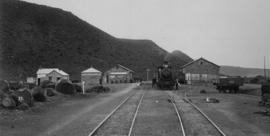 Nelspoort, 1895. Train with Cape 6th Class locomotive in station. (EH Short)