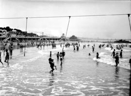 Port Elizabeth, 1930. Bathers in the water at Humewood beach.