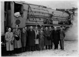 SAR Class 25NC No 3412 with group of men posing, snow on the ground.