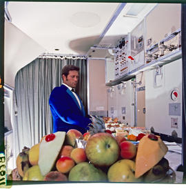 SAA Boeing 747 interior, arranging food in galley.