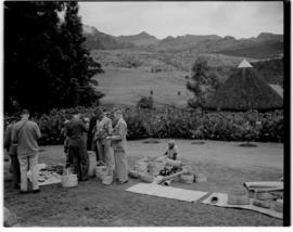 Royal Natal National Park, Drakensberg, 14 to 16 March 1947. Women sitting on lawn selling woven ...