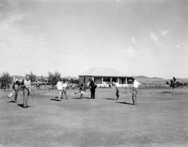 Aliwal North, 1938. Golfers on course with club house in the background.