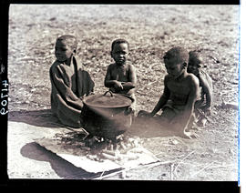 Transkei, 1932. Little boys around cooking pot.
