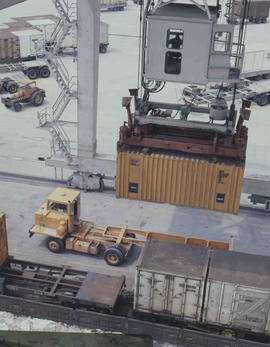 Containers being loaded onto container train.