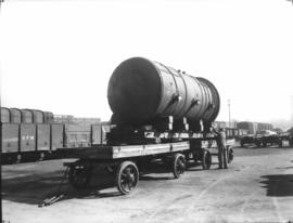 Boiler weighing over 12 tonnes on trailer with CFM goods wagon in the background.