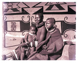 """1951. Ndebele people in front of hut."""
