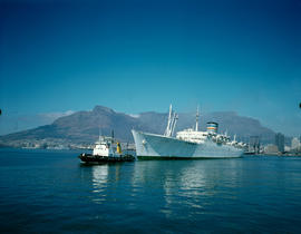 Cape Town. Tug 'JM Botha' leading 'SA Oranje' out of Table Bay Harbour. [D Dannhauser]