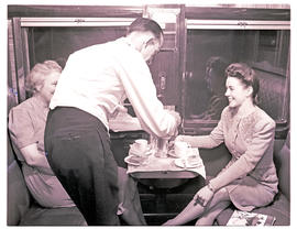 """1946. Blue Train steward serving tea."""