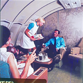SAA Boeing 747 interior , handing out magazines.