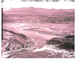 """Knysna, 1935. Aerial view over the Heads and town in the distance."""