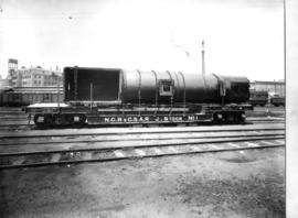 Joint NGR / CSAR well base wagon later SAR type U-1 loaded with a Mallet locomotive boiler.