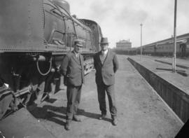 Mr Potts, locomotive foreman and Mr van der Spuy, stationmaster standing next to SAR Class GF.