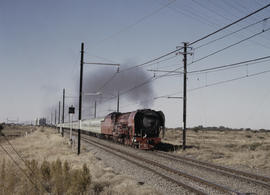 Bloemfontein district, 1984. SAR Class 26 No 3450 'Red Devil' with Drakensberg Express. [D Dannha...