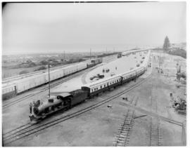 Port Elizabeth, 26 February 1947. SAR Class 6A No 485 at the head of the Pilot Train and a SAR Cl...