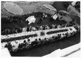 Lourenco Marques, 1959. Conference of General Managers. Large outdoor dining table with guests.