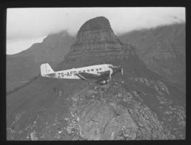Cape Town. SAA Junkers JU-52 passing Lion's Head.