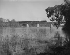 Vereeniging, 1955. SAR Class 15F with train crossing the Vaal River.