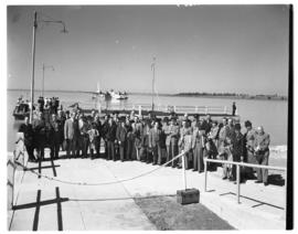 Vaal dam, circa 1948. Group of about 35 men on tour. Posing on jetty before BOAC Solent flying boat.