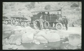 Steam tractor taking water.