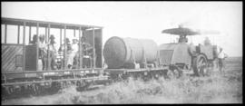 Roadrail tractor with SAR type 4-T-2 tank wagon and passenger 'Garden Bench' type wagon ex CSAR N...