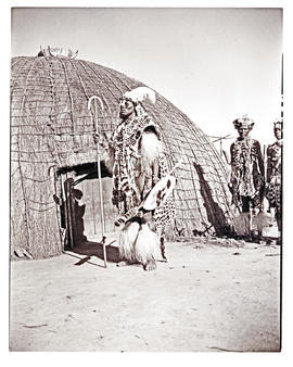 Natal, 1946. Zulu chief in front of hut.