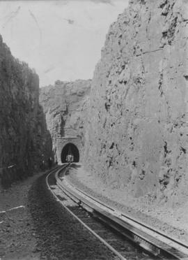 Waterval-Boven tunnel. Western portal with crew working on the roof of the tunnel from a railway ...