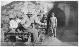 Workers on trolley at entrance to tunnel. (Lund collection)