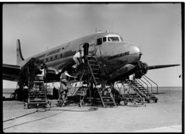 Johannesburg, circa 1949. Rand Airport. SAA Douglas DC-4 ZS-BWN 'Swartberg' being worked on on ap...