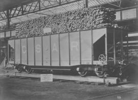 CSAR type J2 high-sided coal hopper wagon later SAR type A-2 loaded with timber.