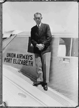 Port Elizabeth, circa 1954. Late Major Allister Miller at Union Airways standing on wing of Junke...