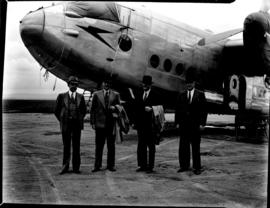 Arrival of Avro York ZS-ATR 'Impala', four men outside aircraft.