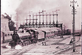 Cape Town circa 1921. SAR Class 15A with main line passenger train 7-Down leaving station with co...