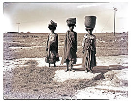 Transkei, 1948. Three women with baskets on heads.