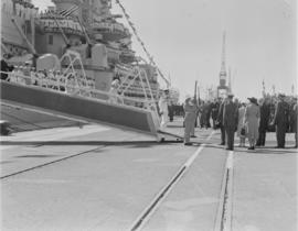 Cape Town, 17 February 1947. King George VI disembarks from 'HMS Vanguard' followed by Queen Eliz...