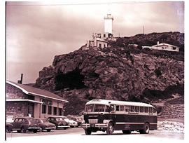 """Mossel Bay, 1961. SAR Canadian Brill MT6106 motor coach below Cape St Blaize lighthouse."""
